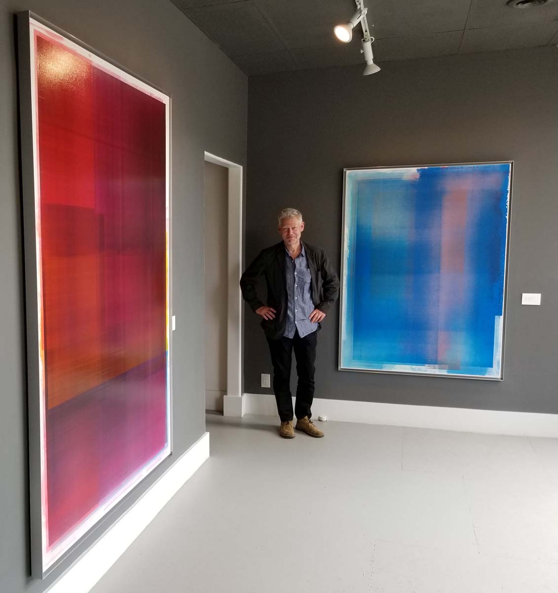 Jonathan Forrest with his artwork