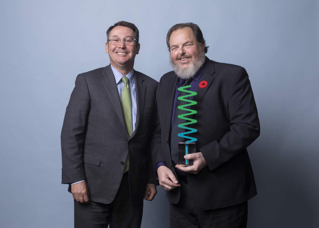 Kim Houghtaling receives his award for Leadership from Sask Arts